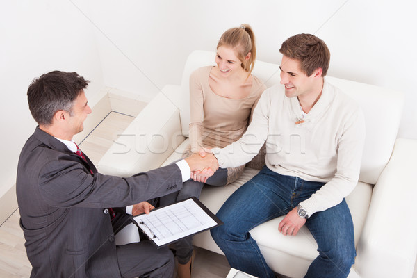 Consultant Shaking Hand With Customer Stock photo © AndreyPopov