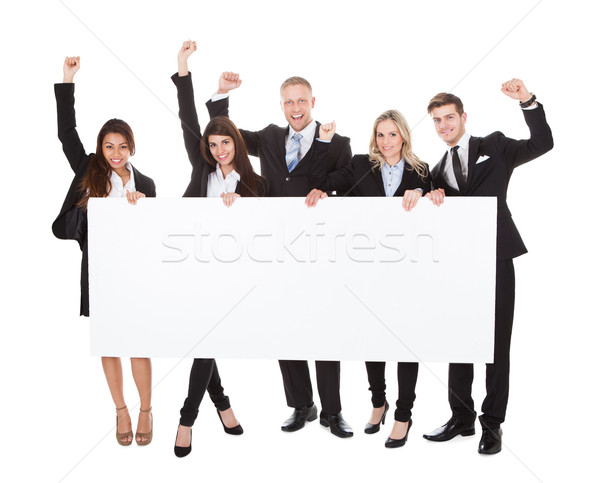 Confident Businesspeople Holding Blank Banner Stock photo © AndreyPopov