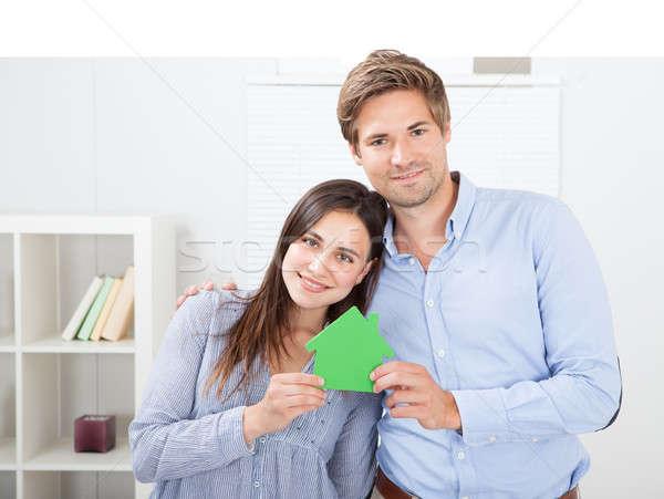 Happy Couple Holding Green House Model Stock photo © AndreyPopov