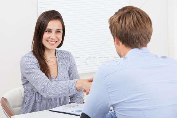 Jelölt kezet fog üzletember boldog női iroda Stock fotó © AndreyPopov