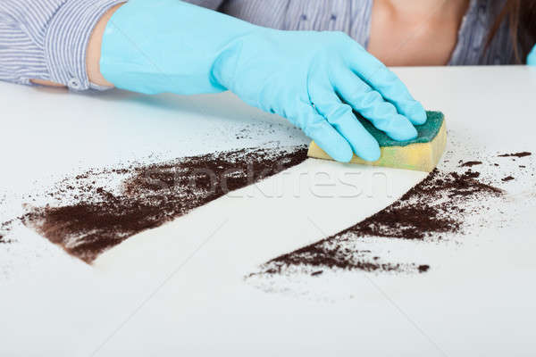Hand Cleaning Dirt On Table With Sponge Stock photo © AndreyPopov