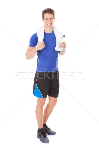Athlete Holding Water Bottle In Hand After Exercising Stock photo © AndreyPopov