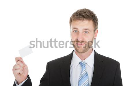 Happy Businessman Holding Visiting Card Stock photo © AndreyPopov
