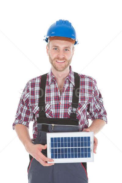 Confident Repairman Holding Solar Panel Stock photo © AndreyPopov