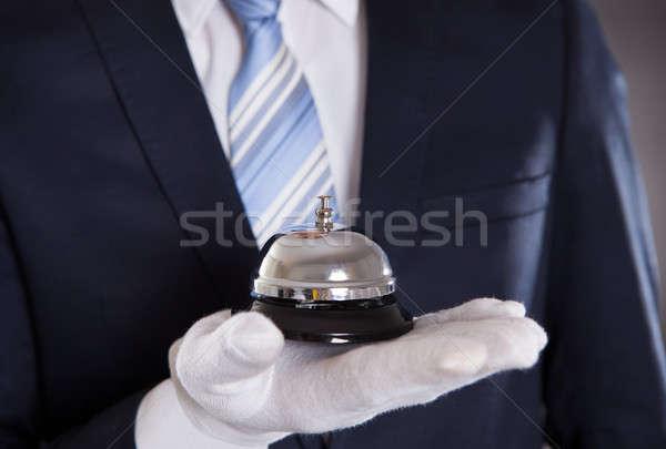 Bellman Holding Bell Stock photo © AndreyPopov