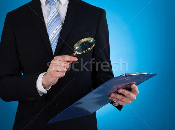 Imprenditore documento lente di ingrandimento appunti blu Foto d'archivio © AndreyPopov