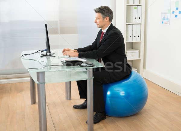 Imprenditore seduta pilates palla ufficio Foto d'archivio © AndreyPopov