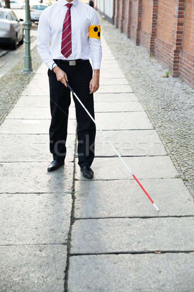 Blind Man Walking On Sidewalk Stock photo © AndreyPopov