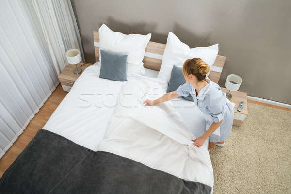 Female Housekeeper Changing Bedding Stock photo © AndreyPopov