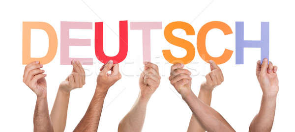 Close-up Of Hands Holding Text Deutsch Stock photo © AndreyPopov