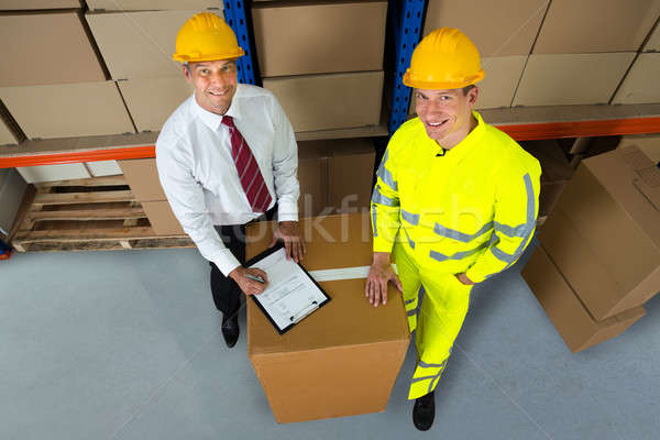 Smiling Warehouse Manager Checking Inventory Stock photo © AndreyPopov