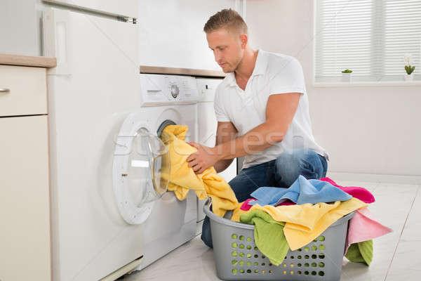 男 汚い 服 洗濯機 小さな ハンサムな男 ストックフォト © AndreyPopov