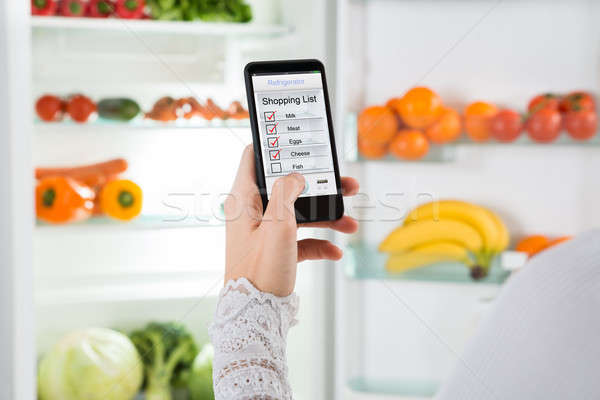Person Hand With Mobile Phone Showing Shopping List Stock photo © AndreyPopov