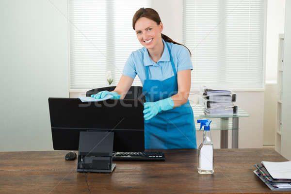 Woman In Workwear Rubbing Computer Stock photo © AndreyPopov