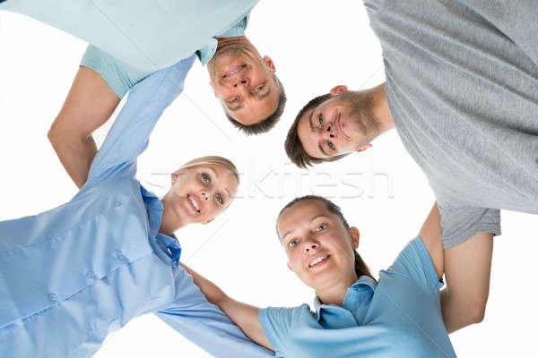 Grupy ludzi kółko patrząc w dół grupy szczęśliwych ludzi biały Zdjęcia stock © AndreyPopov