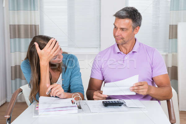 Worried Couple Looking At Unpaid Bills Stock photo © AndreyPopov