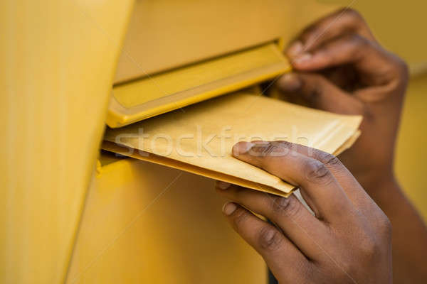 Person's Hand Inserting Letter In Mailbox Stock photo © AndreyPopov
