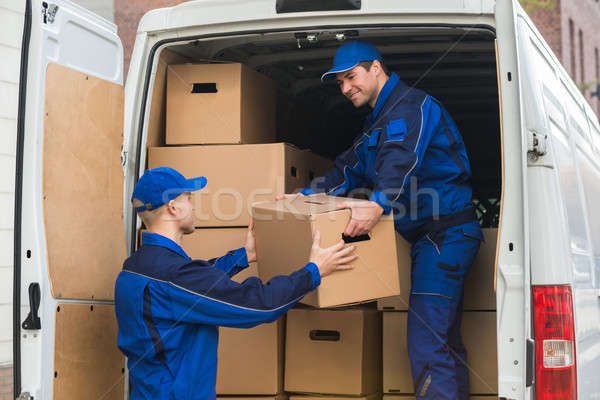 Delivery Men Unloading Boxes From Truck Stock photo © AndreyPopov