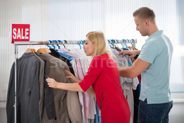 Man And Woman Choosing Clothes In Store Stock photo © AndreyPopov
