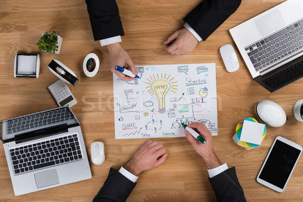 Zakenlieden strategie houten bureau rechtstreeks Stockfoto © AndreyPopov