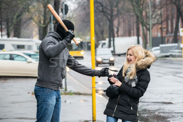 Thief Hitting Woman With Bat While Trying To Steal Purse Stock photo © AndreyPopov