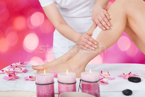 Beautician Waxing Woman's Leg In Beauty Salon Stock photo © AndreyPopov
