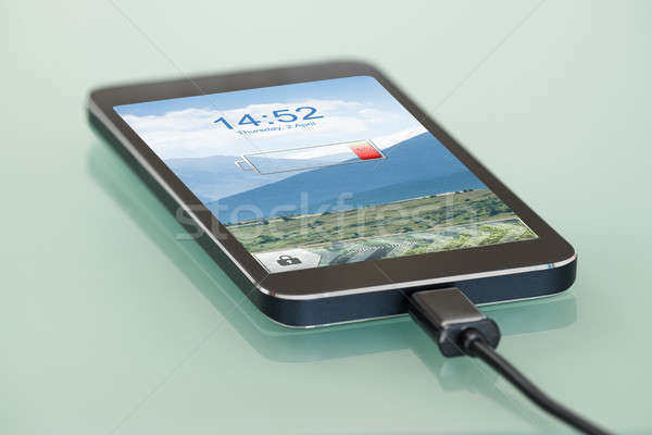 Cellphone With Low Battery Symbol On Charge Stock photo © AndreyPopov