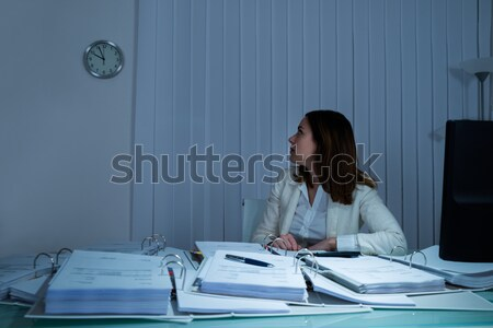 Young Businesswoman Looking At Wall Clock Stock photo © AndreyPopov