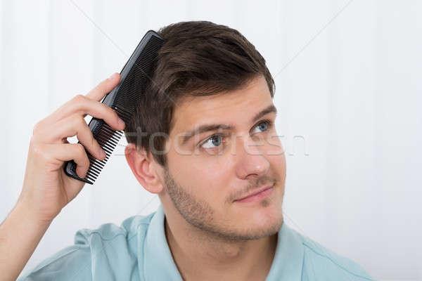 Adam saç tarak genç toplantı Stok fotoğraf © AndreyPopov