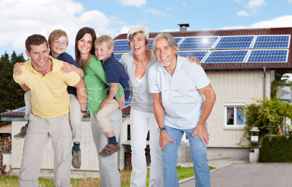 Portrait Of A Happy Family Smiling Outside House Stock photo © AndreyPopov