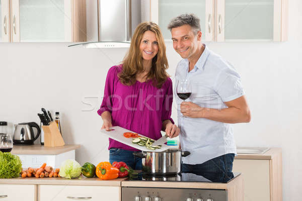 Couple Preparing Food In Kitchen Stock photo © AndreyPopov