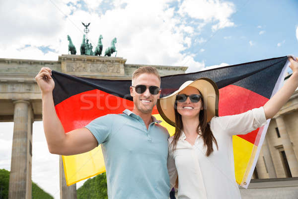 Smiling Couple Holding German Flag Stock photo © AndreyPopov