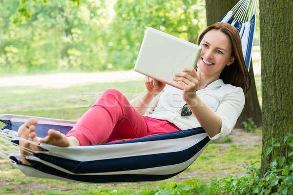 女性 ハンモック デジタル タブレット 小さな 幸せ ストックフォト © AndreyPopov
