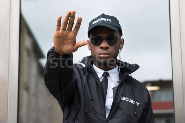 Security Guard Making Stop Gesture Stock photo © AndreyPopov