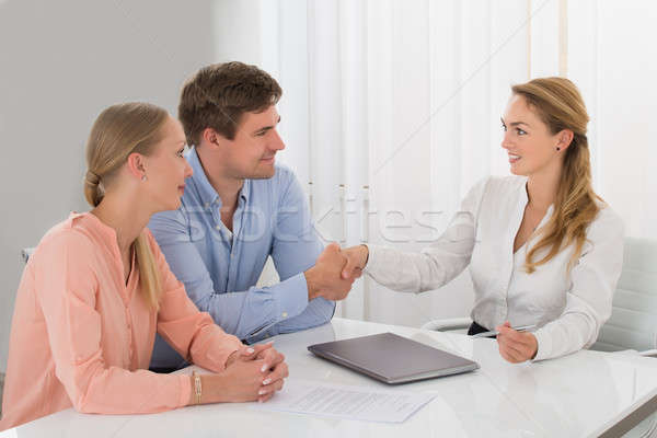 Consultant Shaking Hands With Couple Stock photo © AndreyPopov