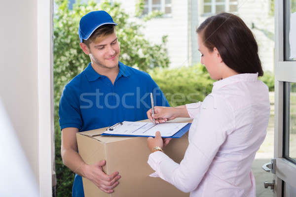 Woman Signing Receipt Of Delivery Package Stock photo © AndreyPopov
