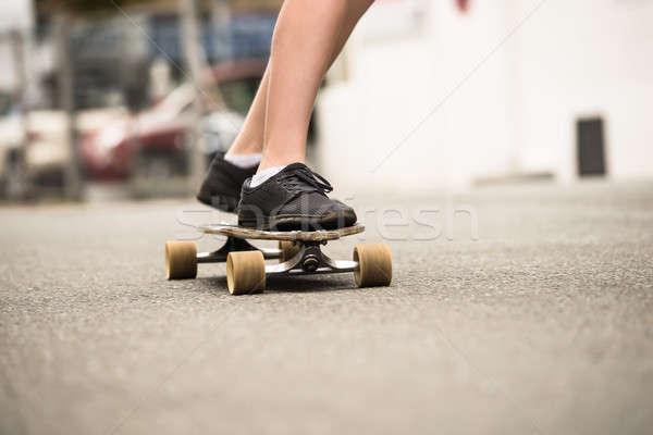 Boy Skating On Street Stock photo © AndreyPopov