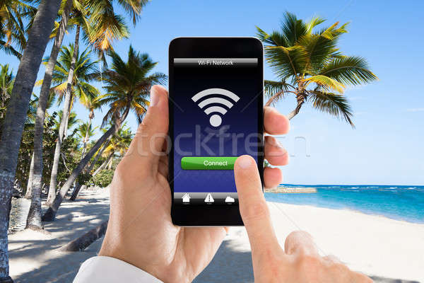 Close-up Of Man's Hand Connected WiFi On Mobile Phone Stock photo © AndreyPopov