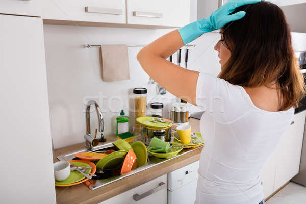 Exhausted Woman Standing In Kitchen Stock photo © AndreyPopov