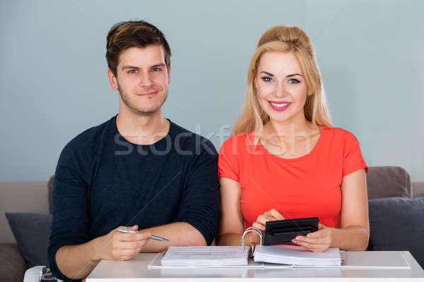 Smiling Couple Calculating Invoice Using Calculator Stock photo © AndreyPopov