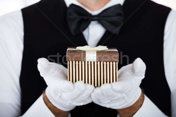 Man's Presenting Small Gift Stock photo © AndreyPopov