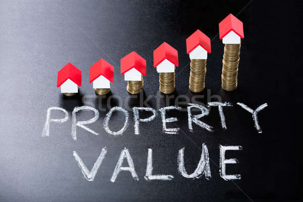Concept Of Property Value On Blackboard Stock photo © AndreyPopov
