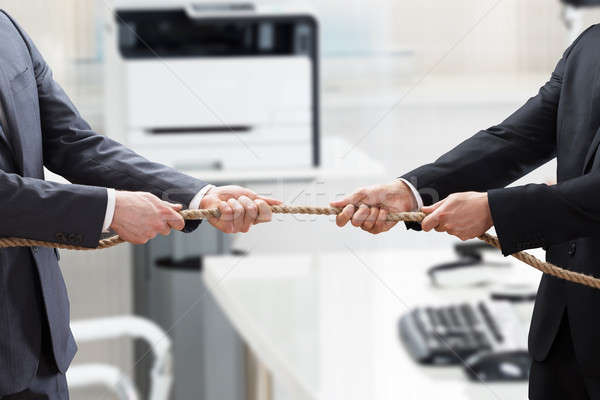 Two Businesspeople Playing Tug Of War Stock photo © AndreyPopov