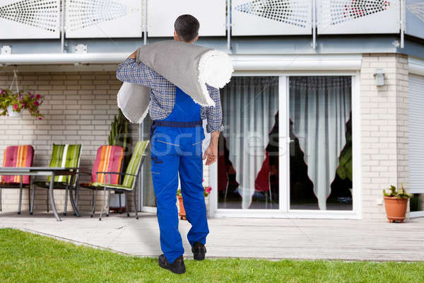 Mover Carrying Rolled Carpet Stock photo © AndreyPopov