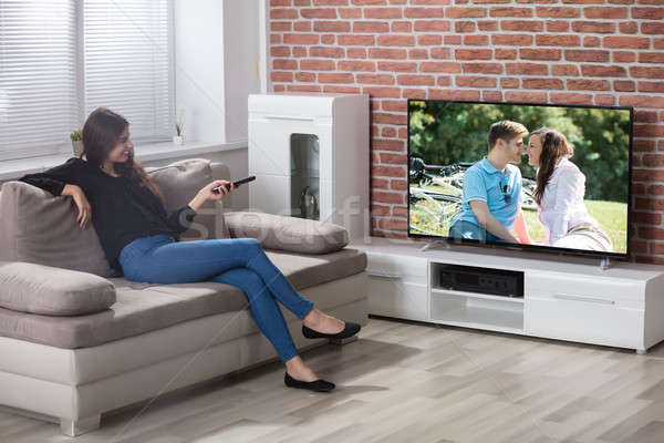 Woman Watching Television Stock photo © AndreyPopov