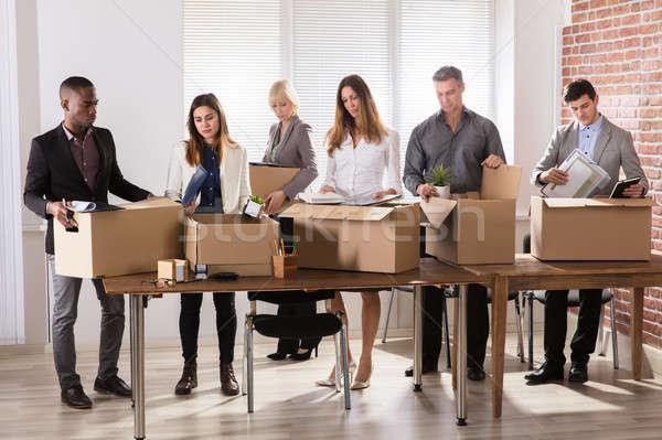 Businesspeople Packing Belongings In Cardboard Box Stock photo © AndreyPopov