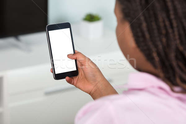 Girl Using Smart Phone Stock photo © AndreyPopov