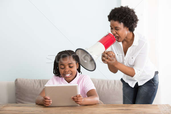 Mother Shouts At Her Daughter In A Megaphone Stock photo © AndreyPopov