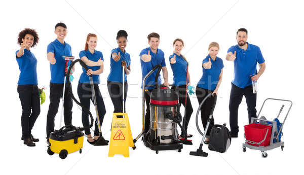 Smiling Multiracial Janitors Gesturing Thumbs Up Stock photo © AndreyPopov