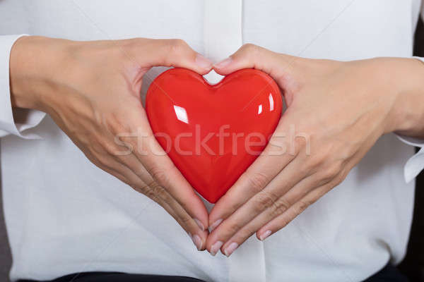 Woman Holding Red Heart Stock photo © AndreyPopov